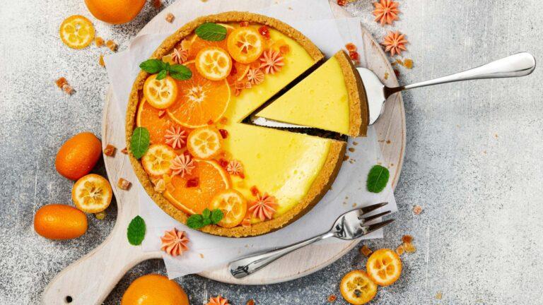 cheesecake with slices of orange and kumquat 16 9