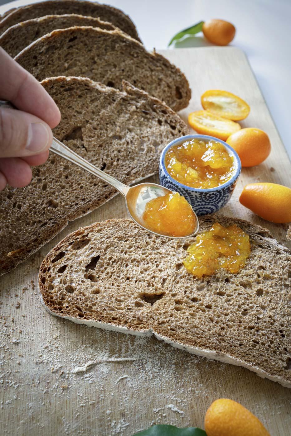 Lazaris private tour tasting corfu hand serving orange jam with spoon slice bread kumquat jam